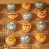 Halloween Cupcakes Apple-brown sugar cupcakes with cinnamon buttercream and candy toppers.
