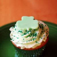St. Patrick's Day Cupcake Vanilla cake, swiss meringue buttercream. Both flavored with creme de menthe.