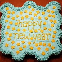 New Year's Cupcake Cake Champagne cupcake cake, with champagne buttercream frosting. Fondant cut-out stars with luster dust for sparkle!
