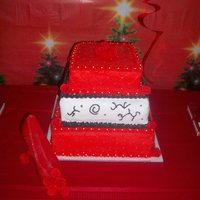Red Christmas Cake this is a red three tier cake. bottom and top tier is diamond pattern. these have silver pearls on each coner. all done with buttercream. i...