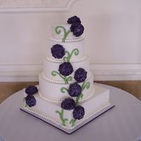Hydrangea Wedding Cake Five tiered fondant covered wedding cake accented with Hydrangeas made from Royal Icing.