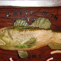 Largemouth Bass This was my very first sculpted fish cake. It was a widemouth bass cake for a friend. I am not the best at painting and my fish tail...