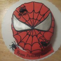 Spiderman Cake Rainbow white cake, fondant covered. Client sent me photo she found on line and asked that I replicate. Web out of fondant extruded from...