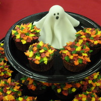 Fall Leaves Cupcakes With Ghost   Orange chocolate with orange vanilla buttercream. Fondant ghost.
