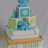Baby Shower Cake This is fun to make. Elephants and bottles were made out of gumpaste. TFL!