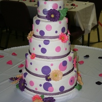 Gerber Daisy Wedding Cake Hand crafted gumpaste daisies adorn my largest cake to date. This cake was fun to make and the bride was happy with the creation!