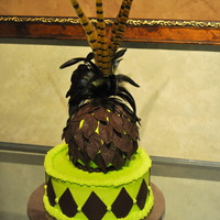 Feathers And Diamonds  Practice cake...want to try my ball cake pan and try molding chocolate.Leaves and diamonds are molding choc, buttercream icing and real...
