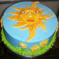 Mr Sun   buttercream, with molded mr sun face, fondant rays, and molded flower faces