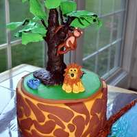 Jungle Cake   buttercream, fondant accents on cake, gumpaste animals, and rkt tree painted with chocolate