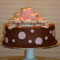 Avery's Cake chocolate bc with fondant dots, bow and banner