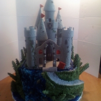 Castle Cake  Second Place in American Culinary Federation Cake Competition.Castle made with Fondant and the Stain glass is melted life saver candy, the...