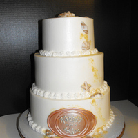 Beach Wedding Cake 6,8,10 inch rounds. Buttercream icing and fondant shells.
