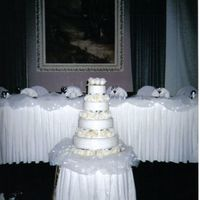 White Wedding Cake All white fondant tiers, chocolate cake with real fresh white roses. Simple white....