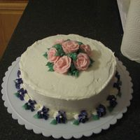 Flower Cake My last cake done in the Wilton class. I forgot to smooth out the buttercream..