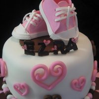 Ezra pink and brown. chocolate fudge cake with chocolate mousse filling. covered with fondant. converse shoes made of gumpaste. i used the...