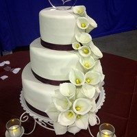 Cascading Callas Gumpaste calla lilies. Anniversary cake on the side