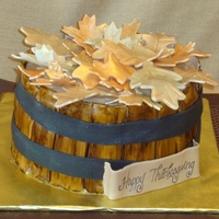 Basket O' Leaves For a family that celebrated Thanskgiving a weekend early, it was a pumpkin spice cake with cream cheese icing. The basket is fondant that...