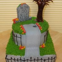 Alan Alan, who was turning 50 and is also a funeral director, got a headstone cake. It was red velvet with cream cheese. The headstone and tree...
