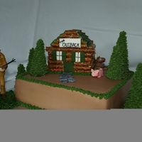 Log Cabin Cake I made this for my father-in-law for his bday. He plans on building a cabin soon and the land he purchased has wild hogs and deer, so that...