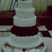 Wedding Cake white fondant covered wedding cake royal icing decorations with beautiful deep red roses