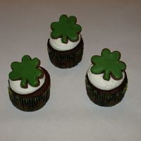St. Patrick's Day Cupcakes   Chocolate cupcakes, vanilla butter cream, and a chocolate sugar cookie to top it off.