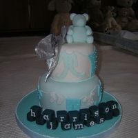 Dscn1713.jpg a stacked cake for the arrival of my nephew harrison james, fondant covered and freehand fondant cutouts of baby clothes ,fondant blocks...