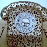 Leopard Print Telephone   a carved fondant covered cake with hand painted leopard print