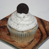 Oreo Cupcake Cupcake is from Cupcake Doctor Recipe and Buttercream dream with oreo crumbs. :)