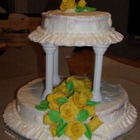 2 Tiered Cake This cake started off bad (cake cracking) and then frosting kept pulling away from the cake. However I love my roses! I think I did a great...