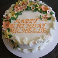 Michelles Birthday   Yellow cake, buttercream frosting, gumpaste flowers & leaves
