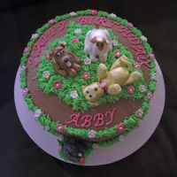 Abby's Birthday Puppies   Chocolate & white marble cake with chocolate bc. The puppies are gumpaste or fondant...tfl