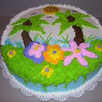 Luau Birthday White cake with buttercream icing & decoration.