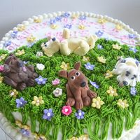 Puppy Dog Cake White cake with puppies I made out of gumpaste. Indydebs butter cream frosting. TFL