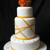 Spring Wedding Fake cake covered with MMF and decorated with silk flowers, ribbon & dragees.