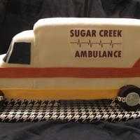 Ambulance This was for our local EMTs Christmas party. First time using edible images (from wal-mart). Not a fan of the look.