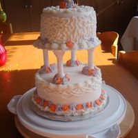 My First Tiered Cake Course 3 Wilton The bottom cake is 1 devil's food and 1 white cake, both torted and filled with chocolate pudding. The top is the same. Covered in BC...