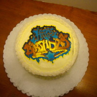 Graffiti Cake Lemon cake with coconut filling, and lemon frosting