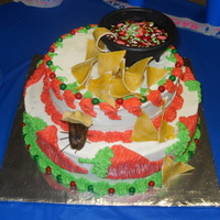 Salsa Themed Cake ( La Cucaracha)   Bc with candy mix salsa and Gumpaste chips, gumpaste roach.