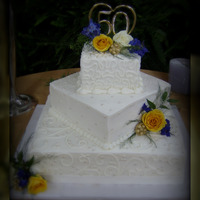 50Th Anniversary Cake This was a 3 tier iced in buttercream with fondant accents, sugar pearls, & gumpaste brooches painted with gold highlighter!