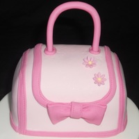 "Pink Purse Cake! Carved from a 4"" round then turned on its side. TFL!"
