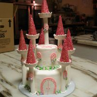Princess Castle Two tiered fondant cake, with gumpaste turrets and sugar cone steeples.