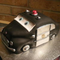 Sheriff Disney Pixar Cars Chocolate cake with Choc frosting, Carved and decorated into the style of the Sheriff from disney cars movie. This was one of two cakes i...