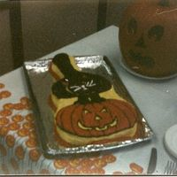 Black Cat-Jack-O-Lantern Cake This cake was made using the guitar pan. It was with wilton decorator icing and was a yellow cake. One of my first attempts at a shape cake...