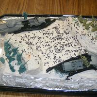 Military Battlefield Cake This cake was made for my sons birthday. THis was a 1/2 yellow 1/2 devils food cake with buttercream icing. The bunkers and towers were...