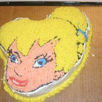 Tinkerbell Cake  This cake was made by my daughter at a Girl Scout cake decorating class. She had to bring the cake already baked. It was strawberry. A...