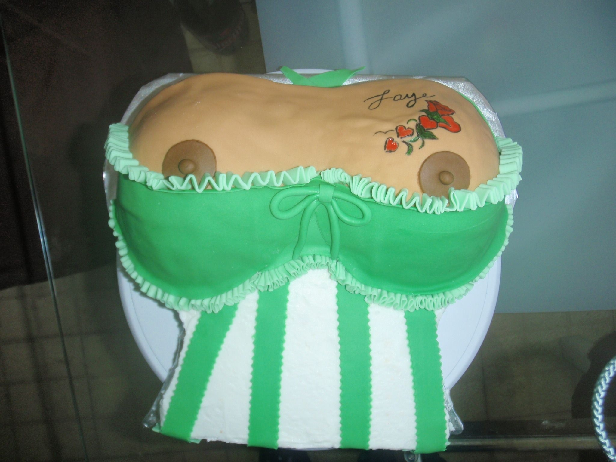 Tattooed Boobies I did this cake for a woman who wanted to give her husband a personal cake for his birthday. The tattoo was hand-painted from her tattoo...
