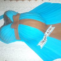 Blue Halter Belly Blue halter dress (I tried to make the pleated effect) w/ brown bow Covered w/ vanilla BC and fondant. TFL