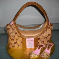 Gucci Purse And Shoes Butter cake covered in fondant..shoes made with shoe template from cc..used gumpaste...TFL