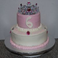 Princess Cake This cake got super simplified from what I had intended. Its a 10 inch lower tier, 6 inch top tier. Iced in BC.
