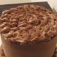 Chocolate Madness Chocolate cake filled with chocolate cream covered with espresso buttercream...